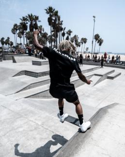 Chris Pierre Skater grinding at venice skatepark